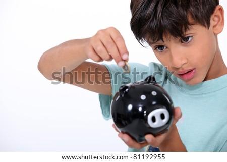 Boy and money box - stock photo