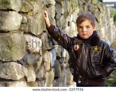 boy and stones wall