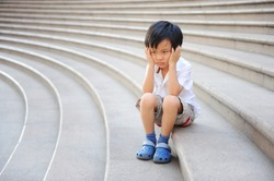 Boy angry and frustrated on the stairs