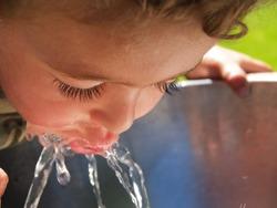 Boy at drinking fountain.