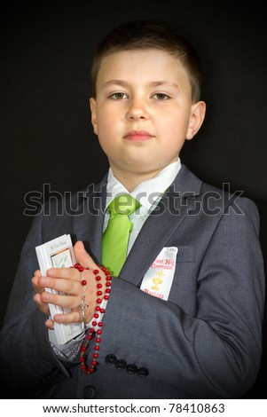 Boy at first communion day