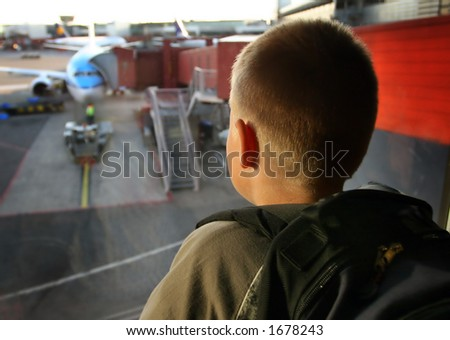 Boy at the airport looking outside, Focus on the face