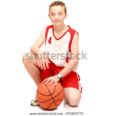Boy athlete with the ball on the isolated