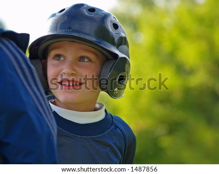 boy baseball player interacting with base coach