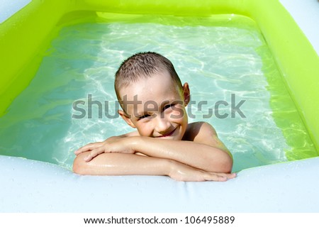 boy bathes in baby pool