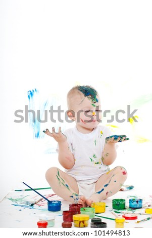 boy bedaubed with bright colors