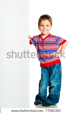 boy beside a white blank for text or image