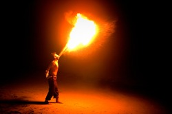 boy breathing fire