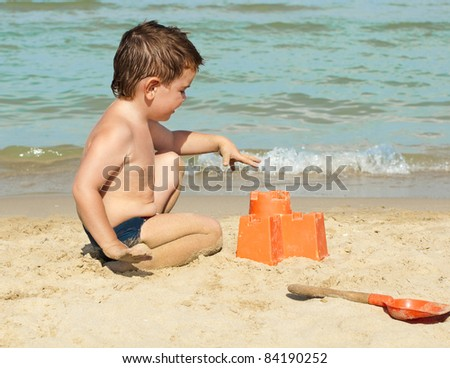 Boy building a sand castle on the beach