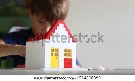 Boy builds a residential with building blocks #1514808893