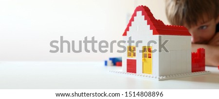 Boy builds a residential with building blocks #1514808896