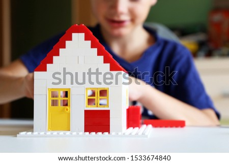 Boy builds a residential with building blocks #1533674840