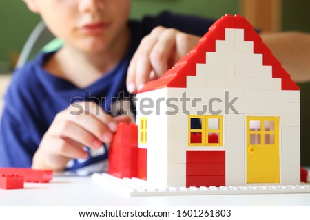 Boy builds his dream house with building blocks