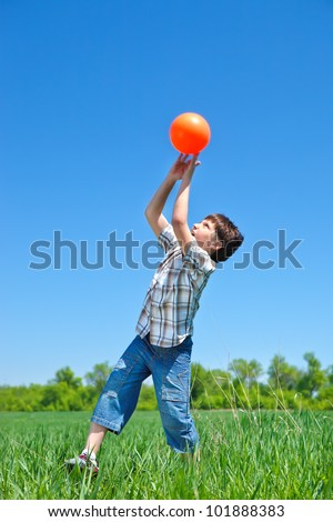 Boy catching a ball in the outdoor