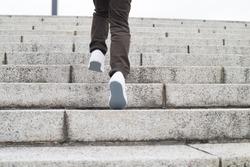 Boy climbing stairs stone