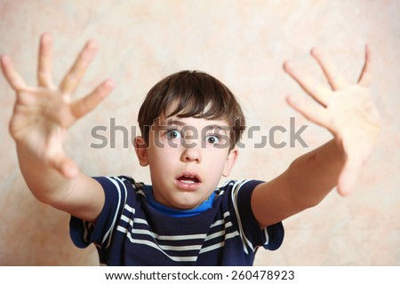 boy close up photo show fear emotion with hand gesture