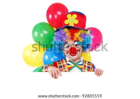 Boy clown holding the blank board
