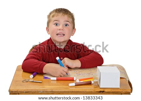 Boy coloring with silly expression
