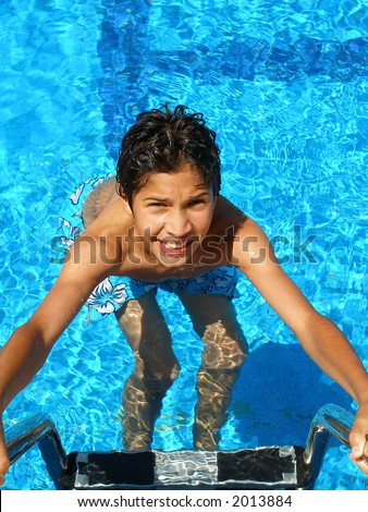 boy coming out of a swimming pool