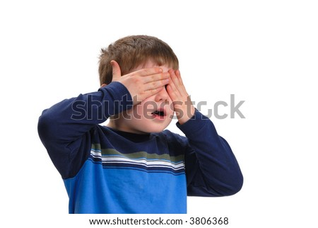 Boy covering his eyes with his hands, isolated on white