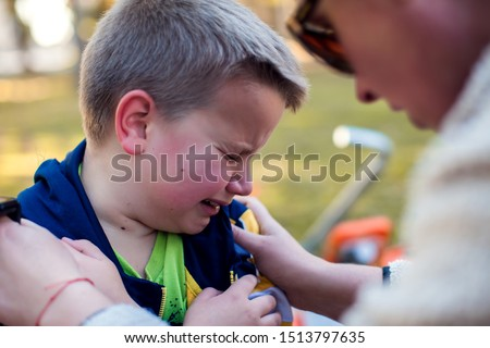 Boy crying and mom trying to calm him down. Children, parents and emotions concept