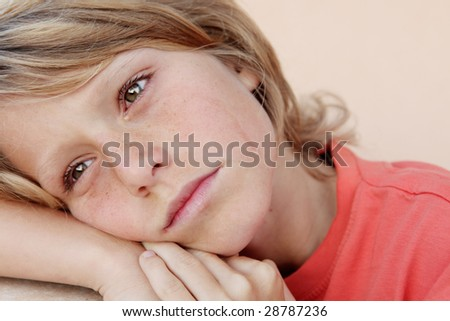 boy crying with tear drops showing