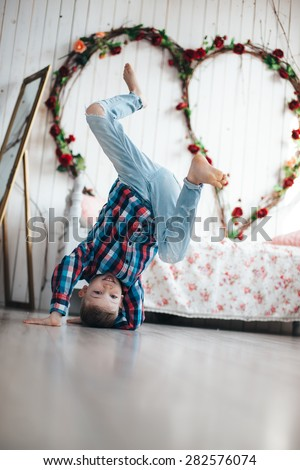 boy dancing break dance and stand on his head