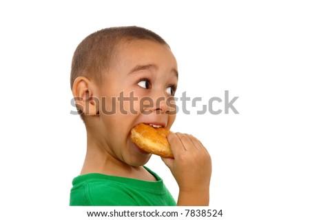 Boy devouring a donut