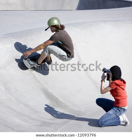 Boy dies tricks at the skateboard park as girl videotapes