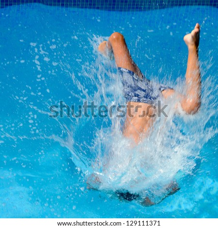 Boy Dives Into The Pool