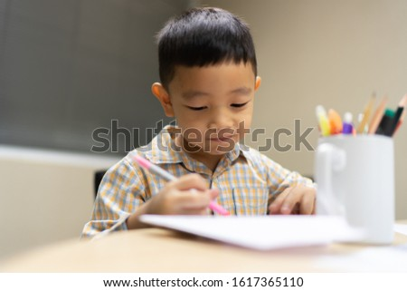Boy do and smile on his  homework is easy