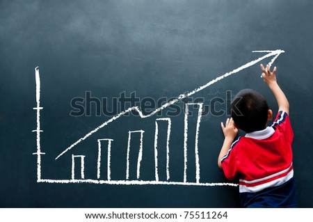 stock photo : boy drawing sales report on the wall