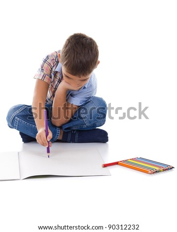 Boy drawing with a pencil