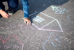 Boy drawing with chalk home orphan child dream