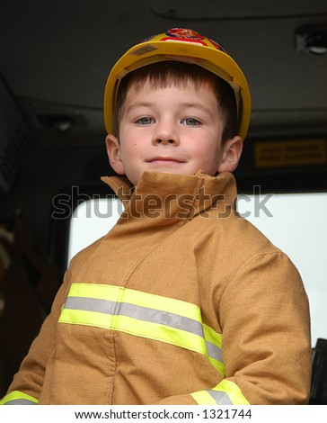 boy dressed as fire fighter