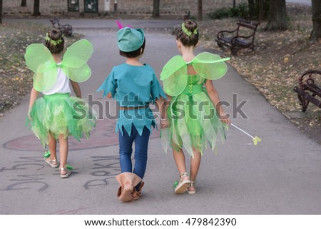 Boy dressed as Peter Pan and two girls dressed as fairies