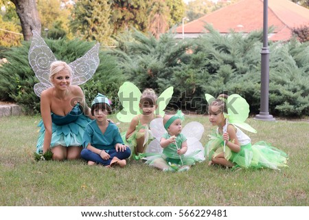 Boy dressed as Peter Pan, two girls and baby in fairy costume. Fairies