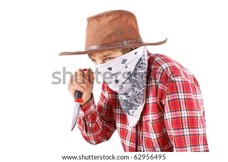 boy dressed up as bandit with knife on white