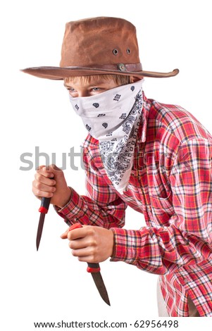 boy dressed up as bandit with two knives on white
