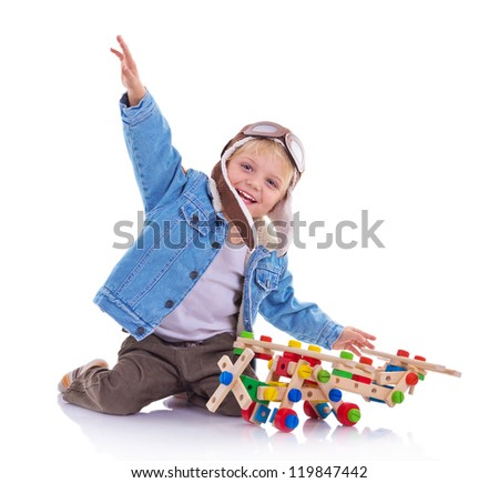 Boy dressed up in pilots jacket and hat isolated over white