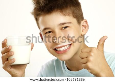 boy drink milk on white - stock photo