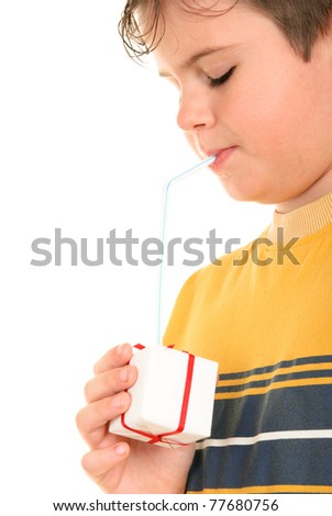 Boy drinks from gift through tubule on white background