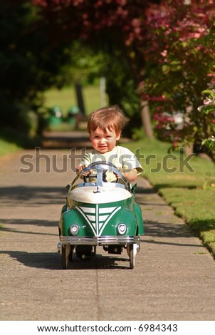 stock photo : boy driving pedal car. Save to a lightbox ▼. Please Login.