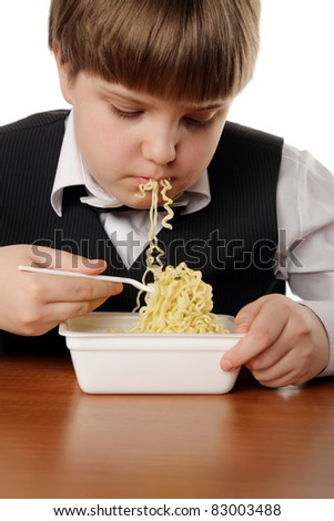 boy eating chinese instant noodles isolated on white
