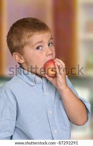 Boy Eating Healthy Apple - stock photo