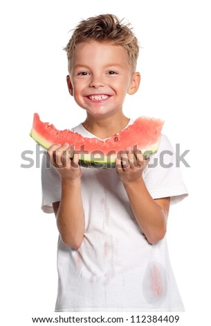 Boy eating slice of watermelon isolated on white background