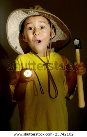 boy exploring with flashlight gets frightened