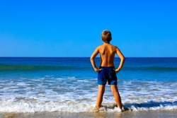 boy, foot on the sea- beautiful beach
