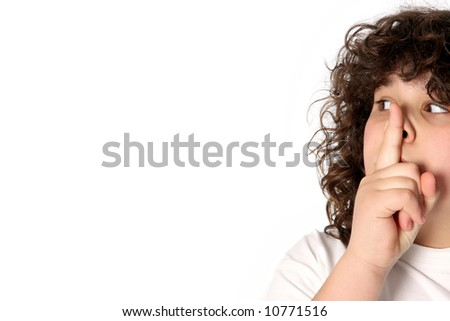 boy gestures for silence on white background - stock photo