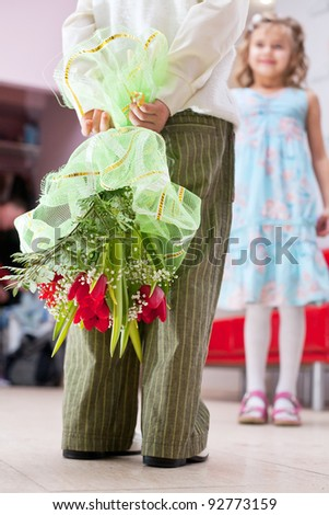 boy gives a bouquet of flowers